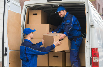 two movers with moving boxes