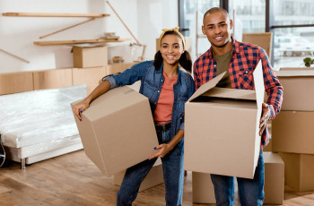 Couple packing for moving