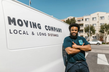 professional mover in front of its white relocation truck