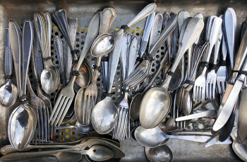 Pile of forks and spoons