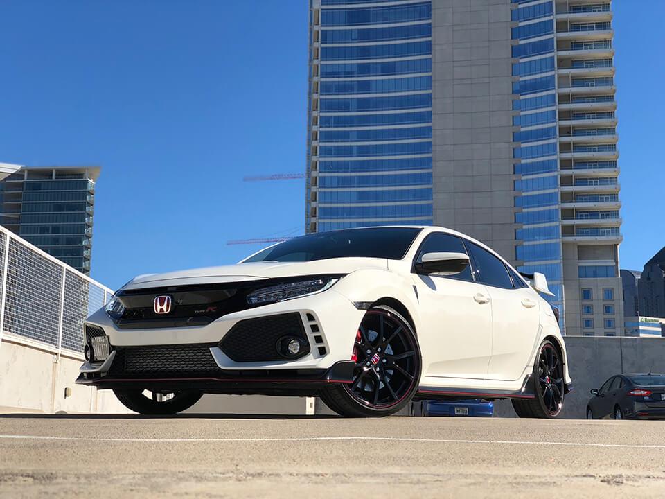 White Honda Civic on the parking lot