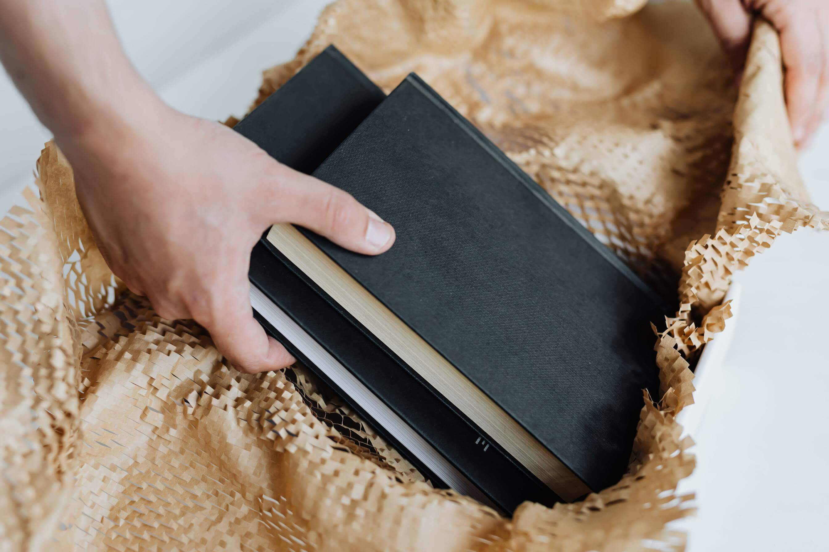 Placing books into a box