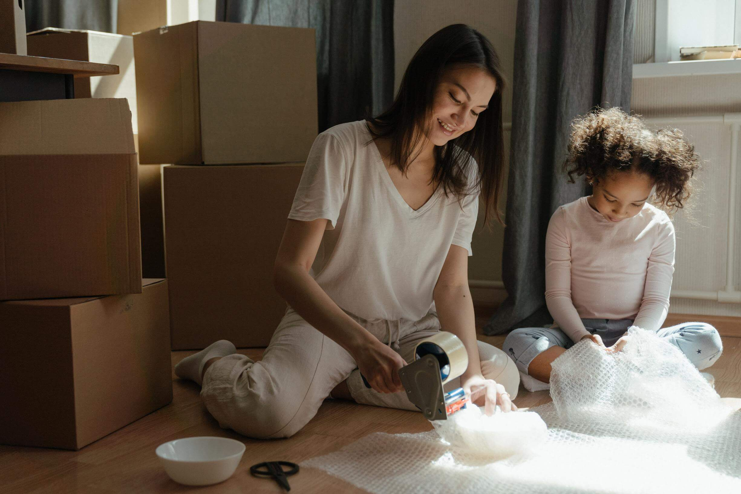A woman and a child using bubble wrap