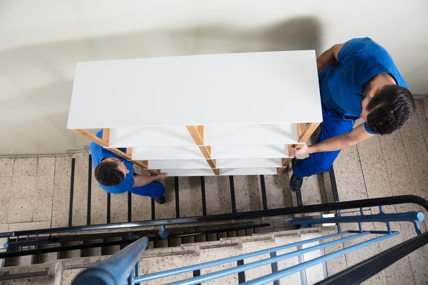 Workers carrying a shelf