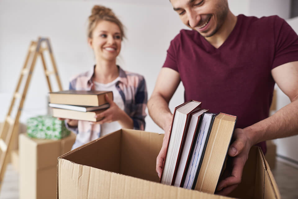 Book decluttering can be emotional, but try to box up only the books you'd take with you on a desert island
