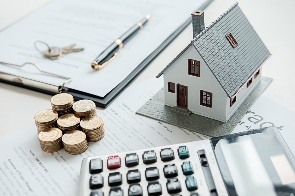 A residence model, a calculator, and money