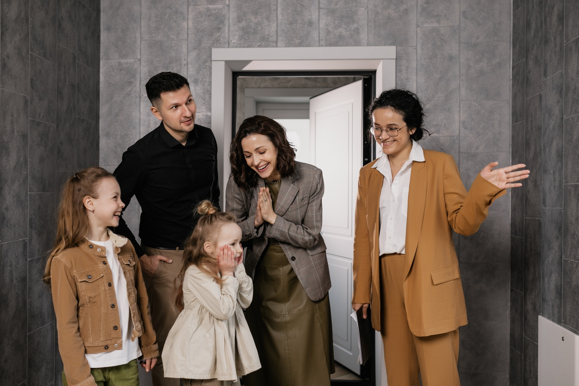 A family with their realtor