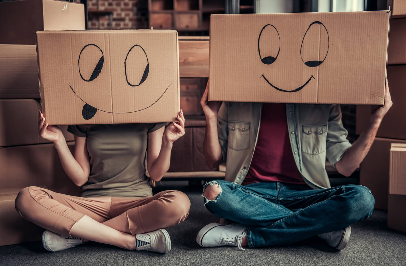 Two people with boxes on their heads