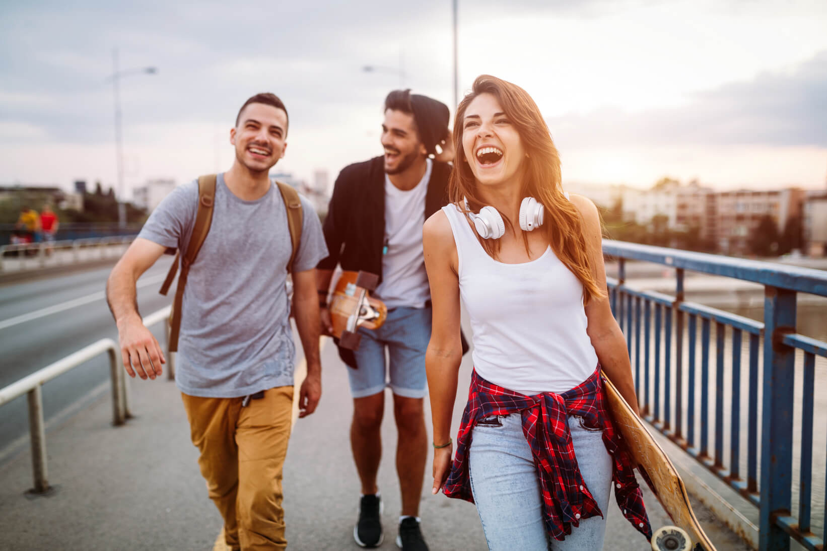 Three people walking and laughing
