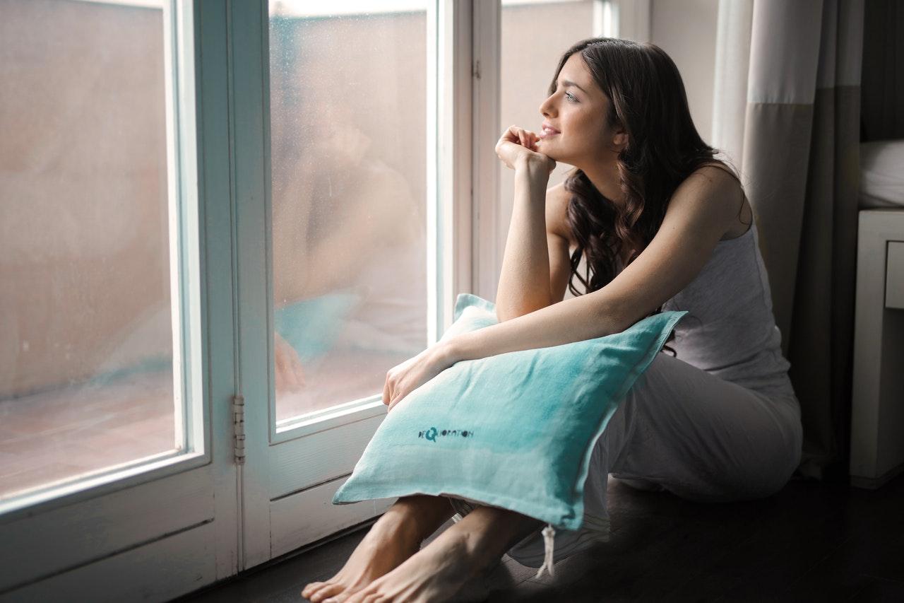 A woman holding a pillow