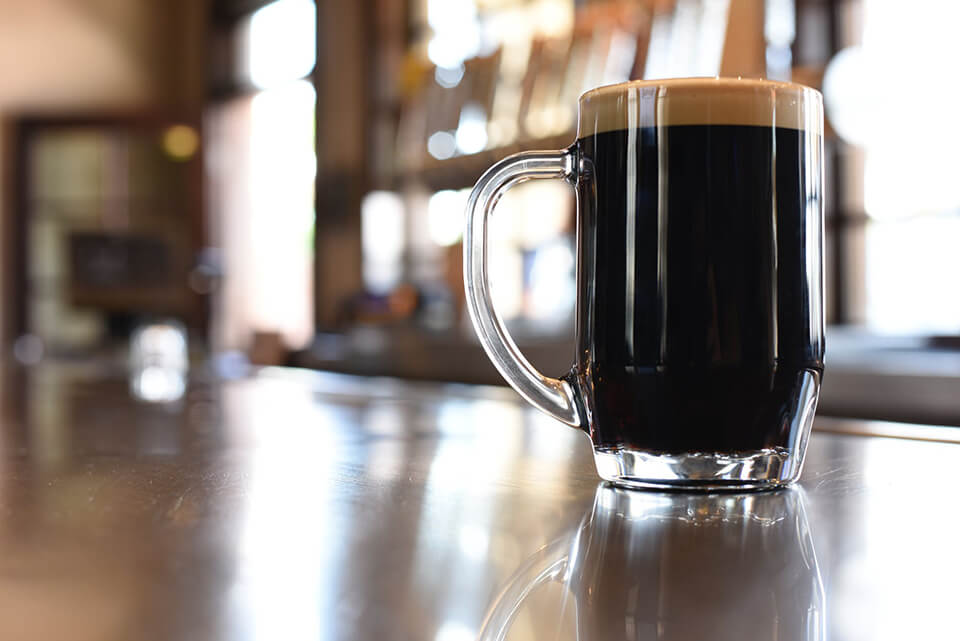 A full beer mug on a table