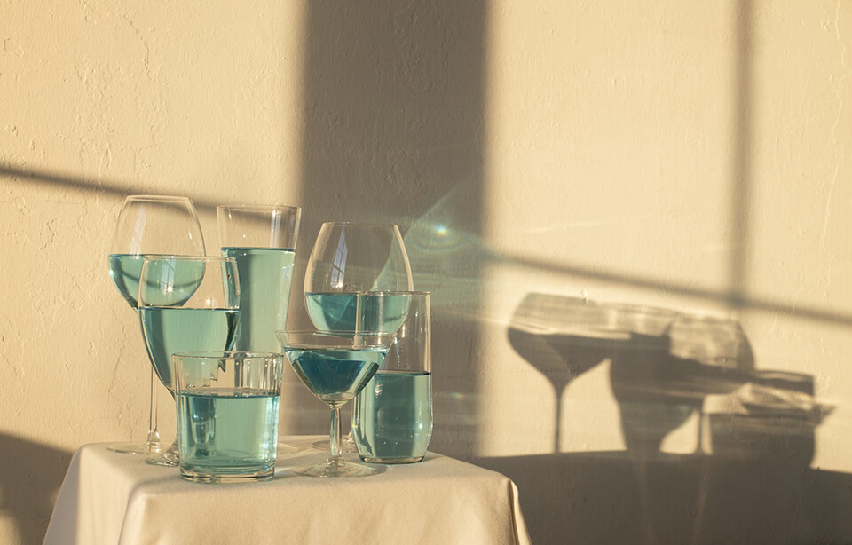 Glassware with blue liquid on a small table