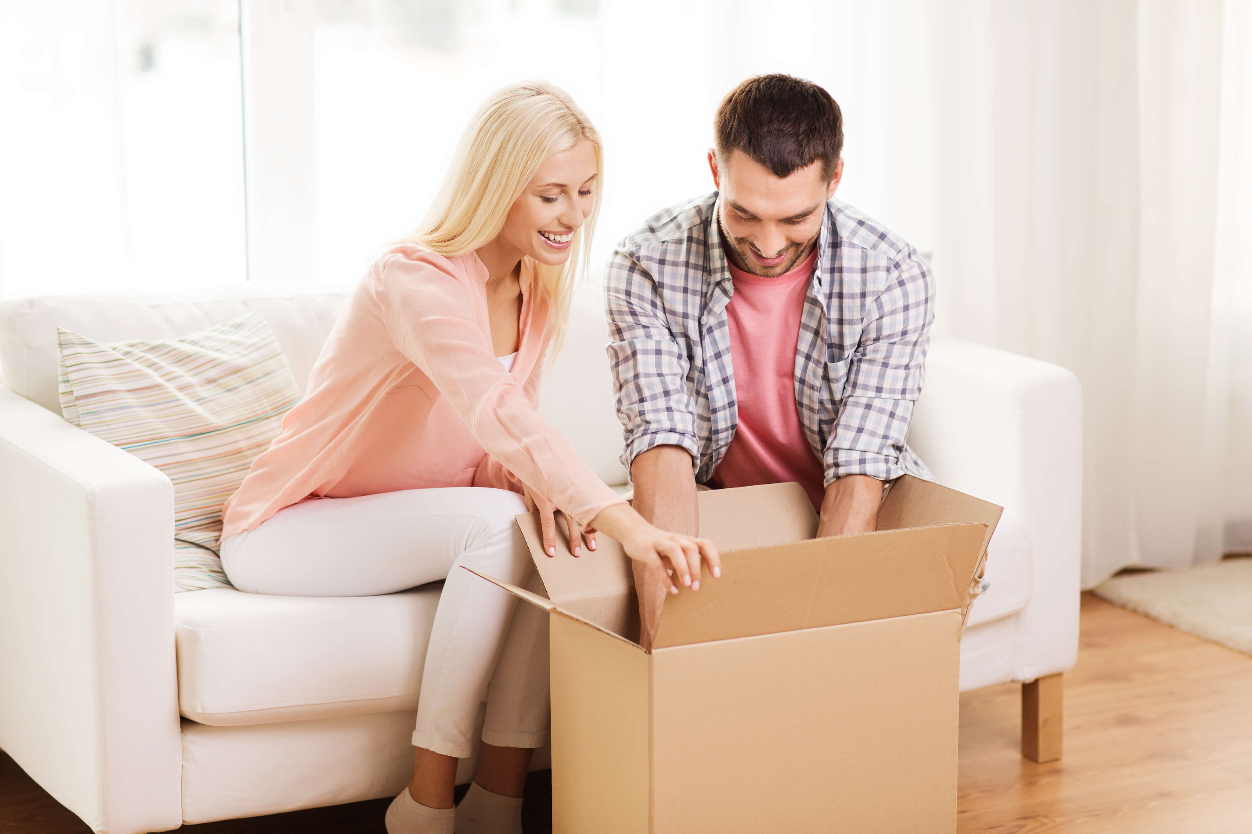 A couple looking at a new box for moving