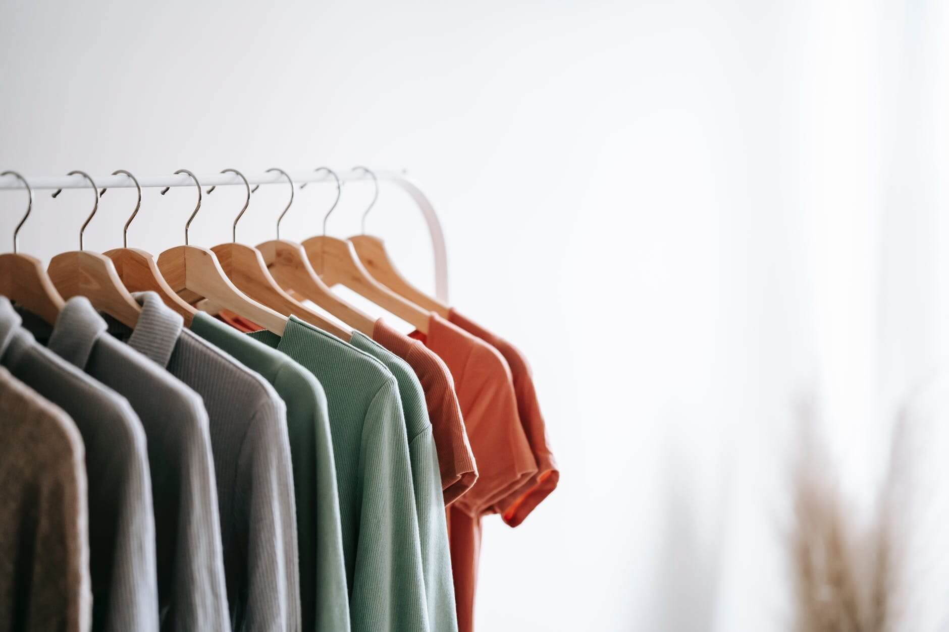 A clothing rack with T-shirts on it