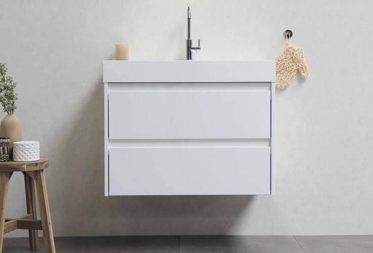A floating bathroom cabinet with possible storage space beneath