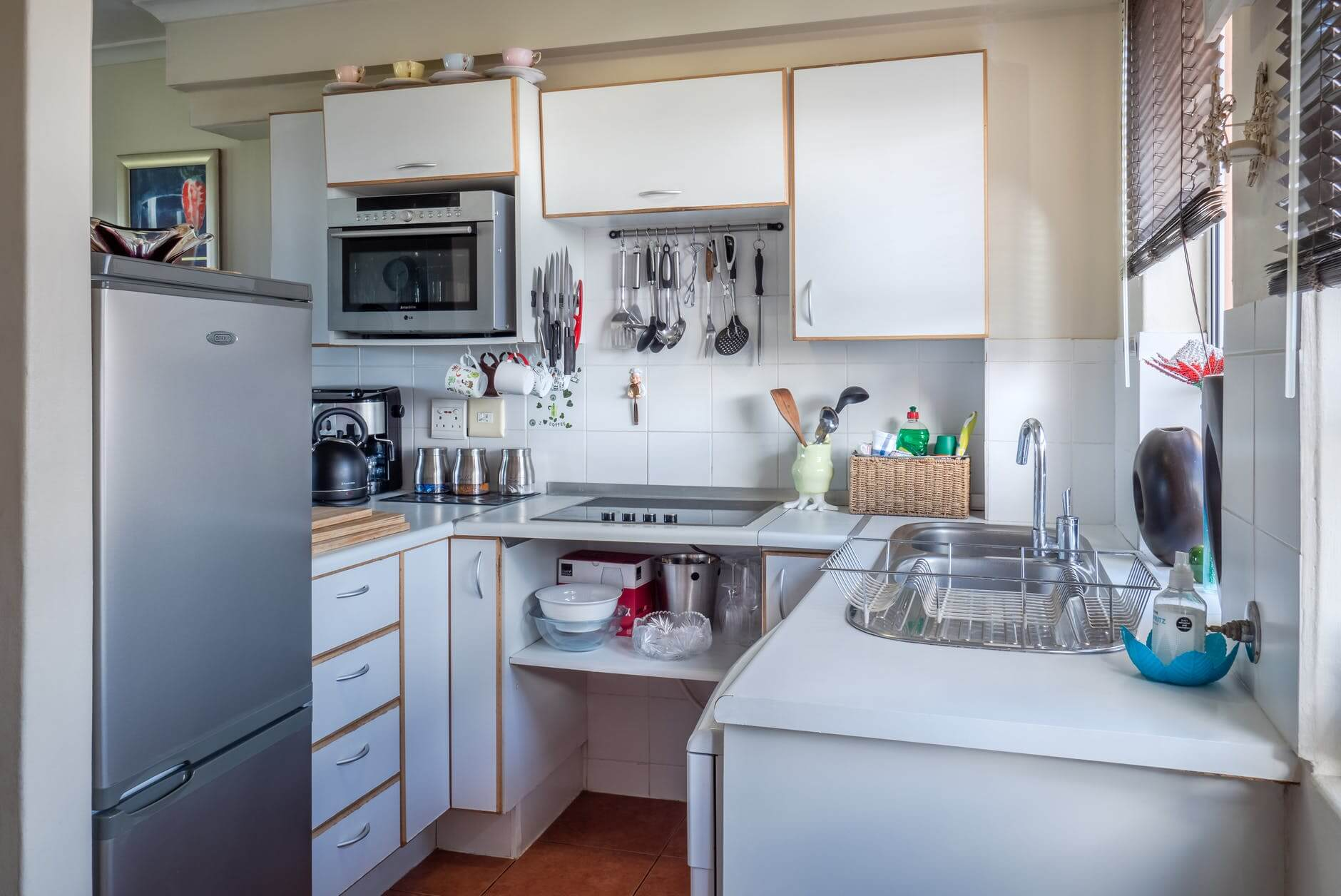 A kitchen with narrow cabinet units