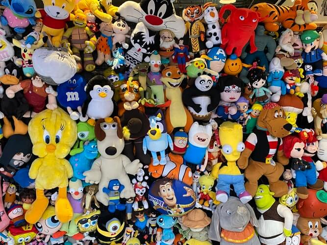 A pile of stuffed toys that should be organized