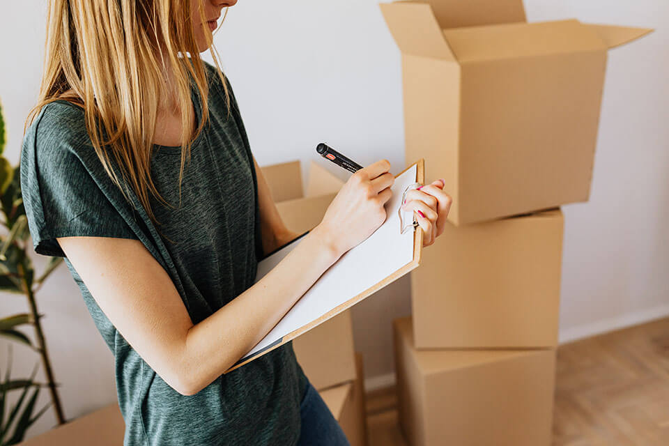 A woman deciding to use a moving app to compare moving companies