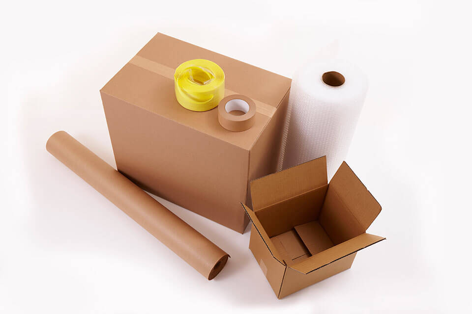 Packages, tape, bubble wrap, and paper roll