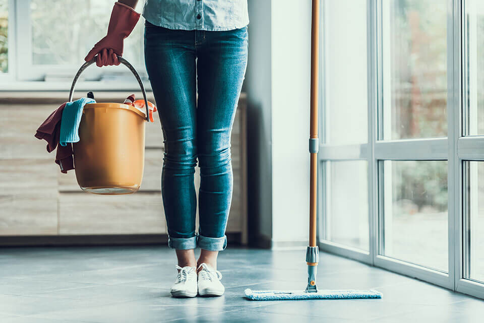 A girl cleaning an apartment before the moving company carries in her items