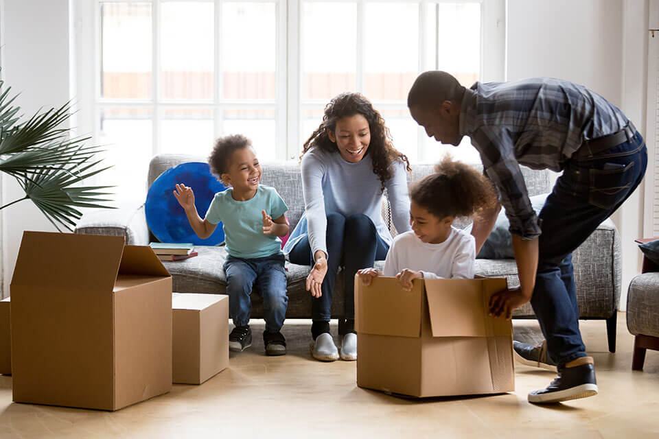 Parents and their children playing and unpacking