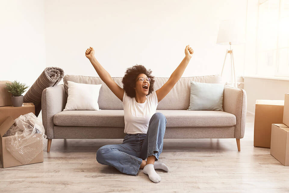 A woman happy that she used a moving company app