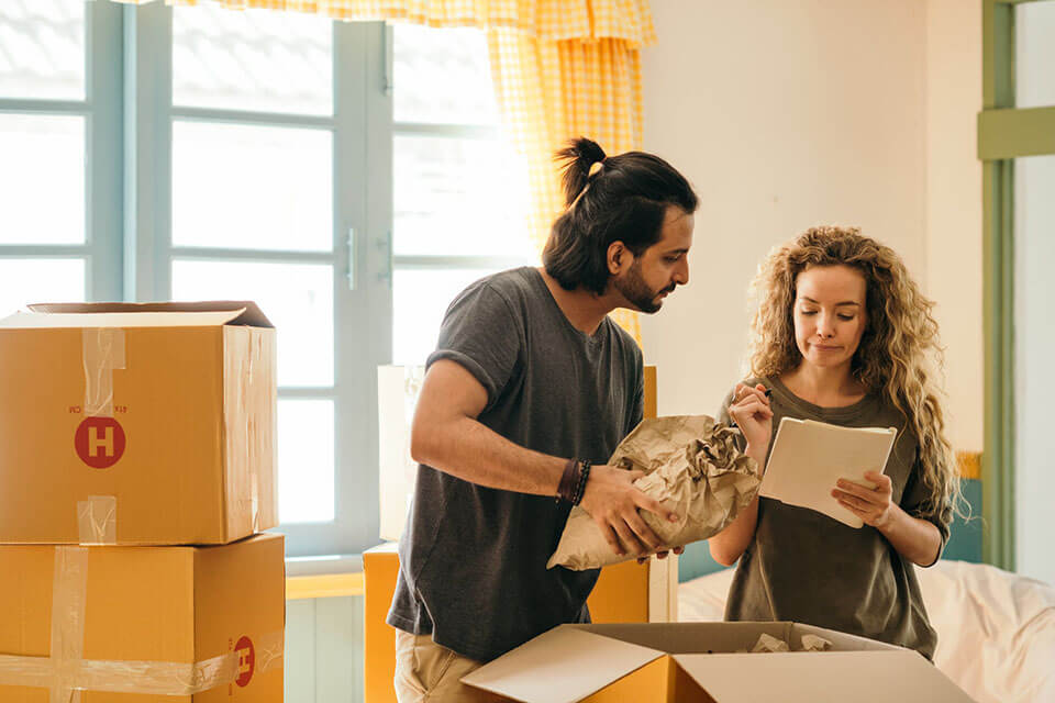 Couple making a list of moving companies