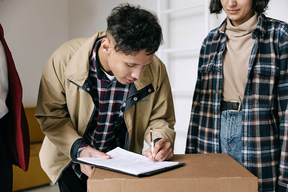 Man signing a contract with a moving company