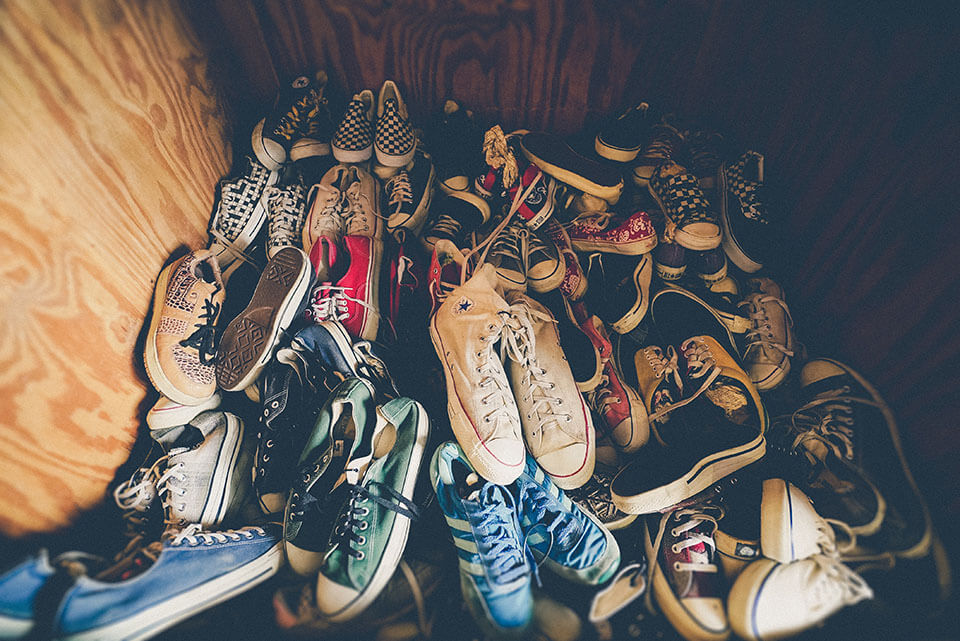 Footwear piled up for a moving company to relocate
