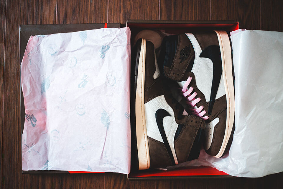 Sneakers packed in a box before searching for an app for moving