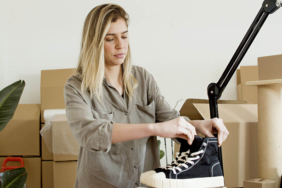 A woman preparing for a moving company