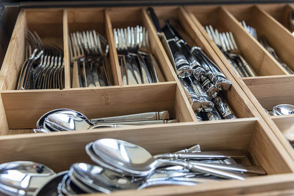 Silver set in a wooden tray ready for relocation with one of the moving companies found on the Mod24 moving app