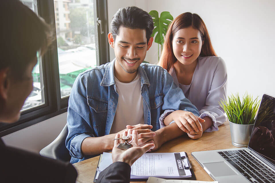 a young couple getting a home together after using a moving app