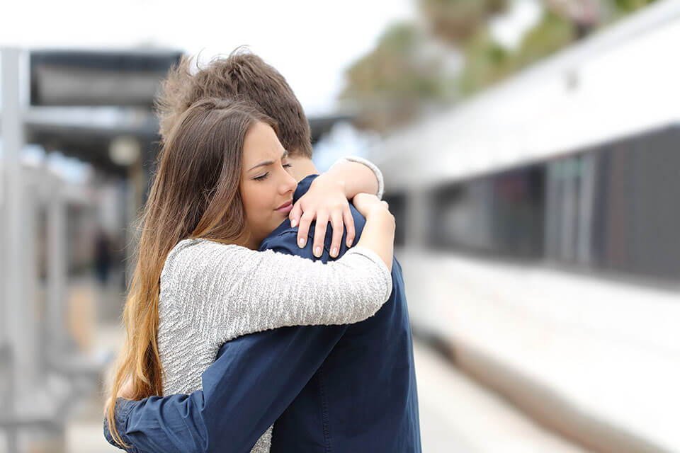 A couple hugging each other after searching for moving companies