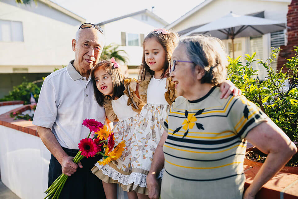 Grandparents and their grandchildren enjoying a sunny day