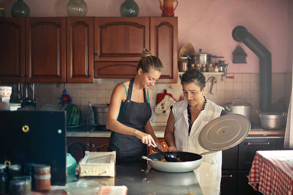 A mom and her daughter cooking a meal