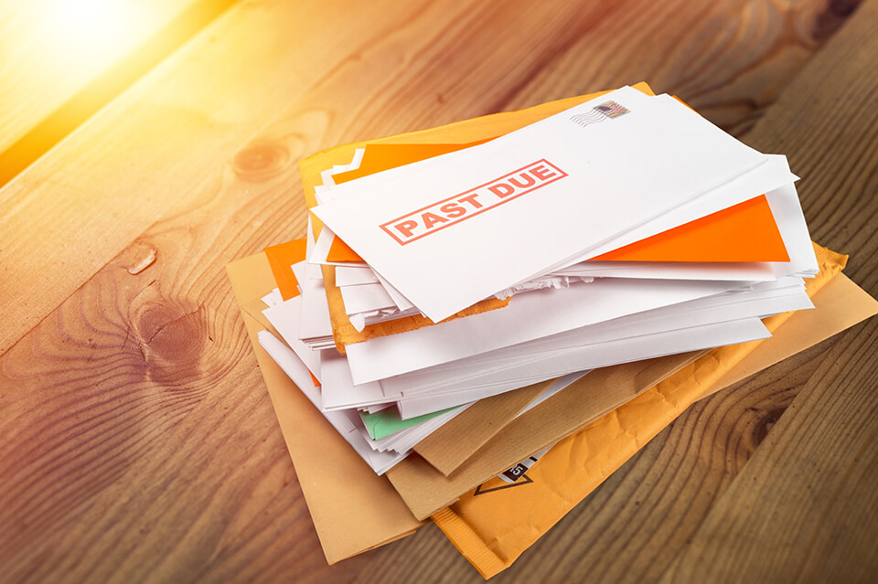 A stack of mail and unpaid bills