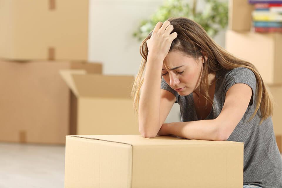 Depressed girl handling her move