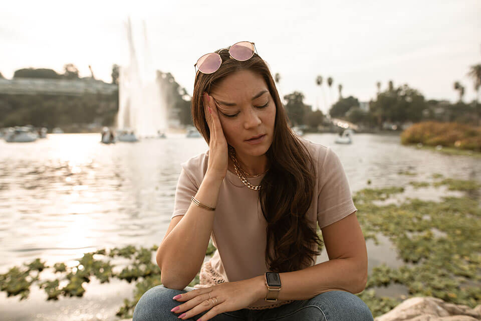 Girl in a park after relocating with a company she found on the app for moving
